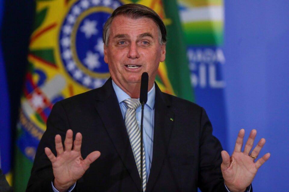 brazil's president jair bolsonaro gestures during a ceremony at the planalto palace in brasilia