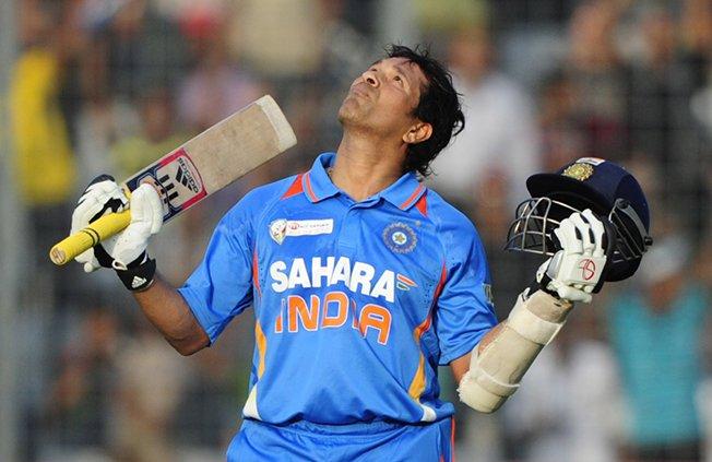 indian superstar sachin tendulkar reacts after scoring his 100th century