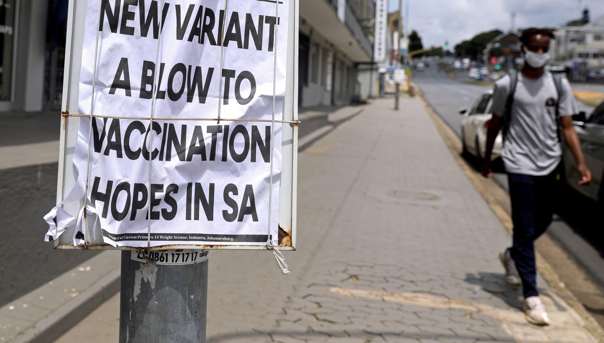 file photo: a man walks past newspaper billboards during the coronavirus disease (covid 19) outbreak in johannesburg