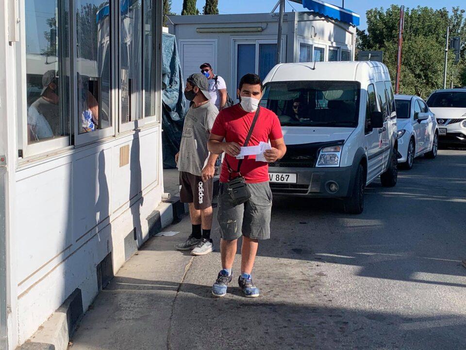 People cross through the Ayios Dometios checkpoint (Christos Theodorides)