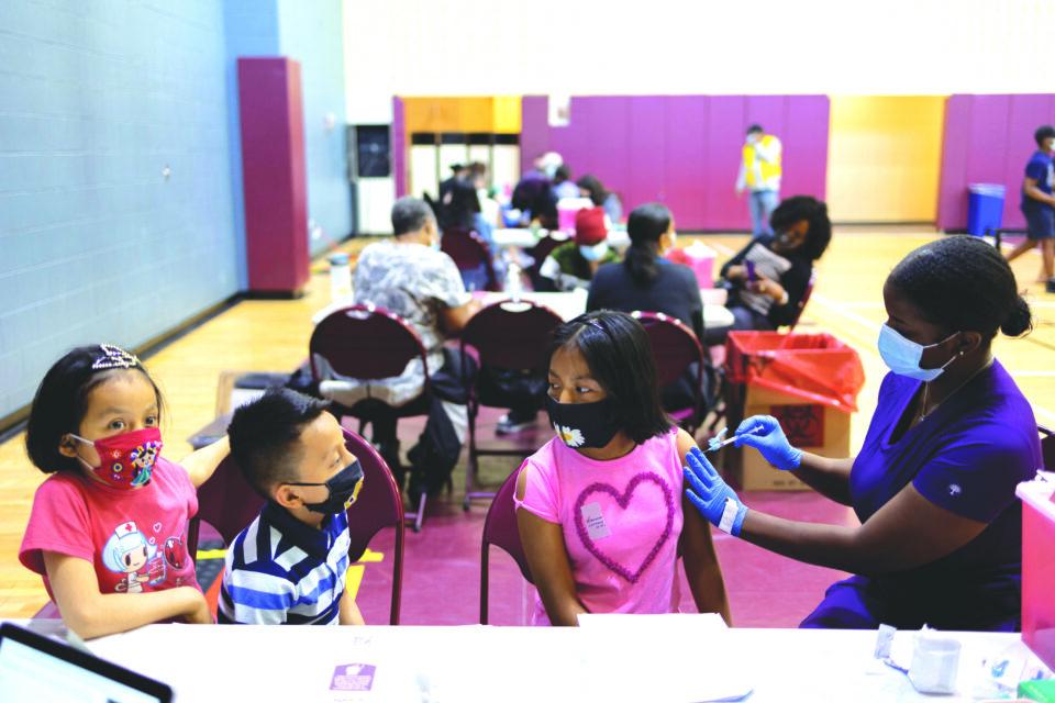adolescents receive covid 19 vaccine