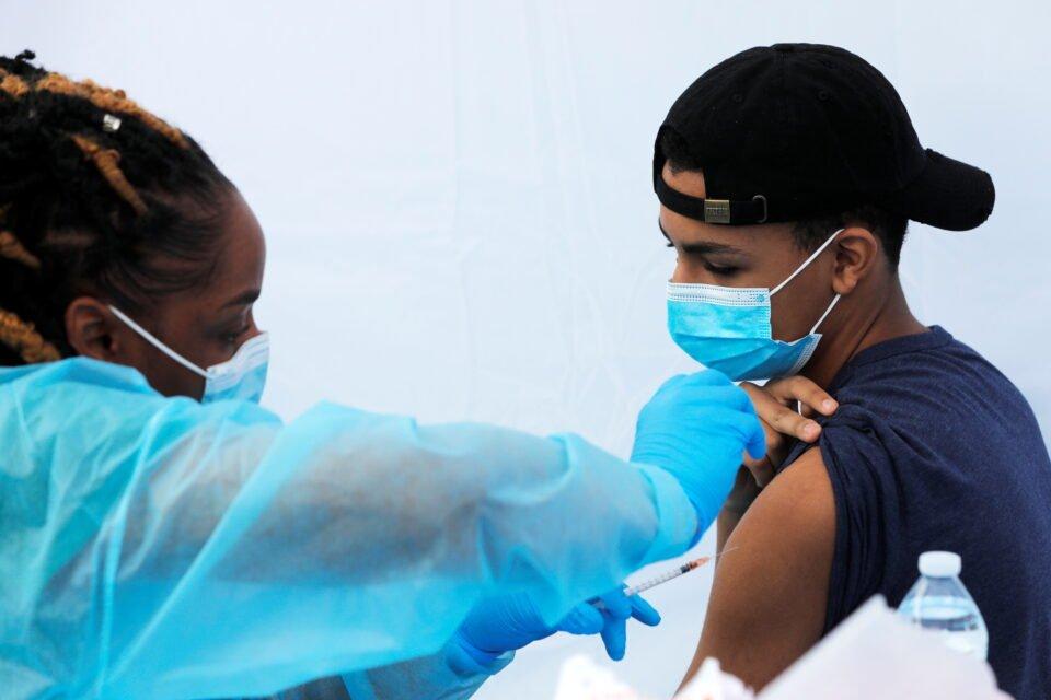 coronavirus disease (covid 19) vaccination event outside the bronx writing academy school in new york city