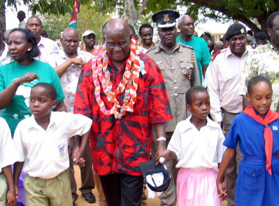 file photo: former zambian president kaunda walks with children in ganze village in kenya
