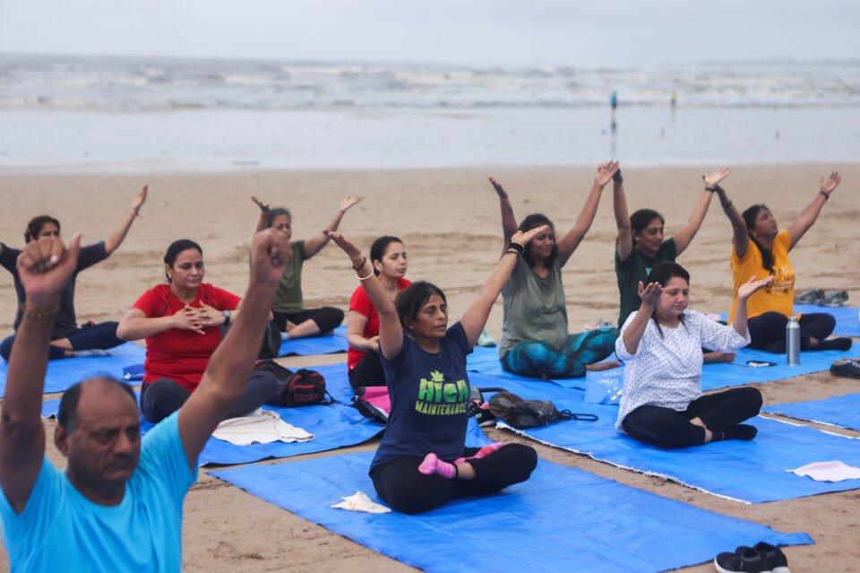 people exercise on a beach amidst the spread of the coronavirus disease (covid 19) in mumbai