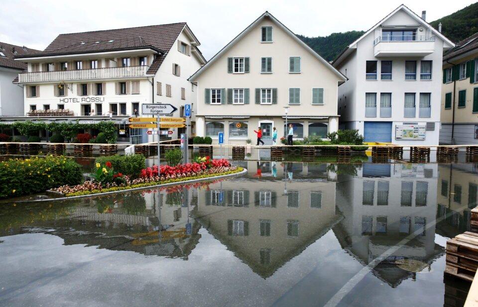 The village square flooded after torrential rain is seen in Stansstad, Switzerland July 15, 2021. REUTERS/Arnd Wiegmann