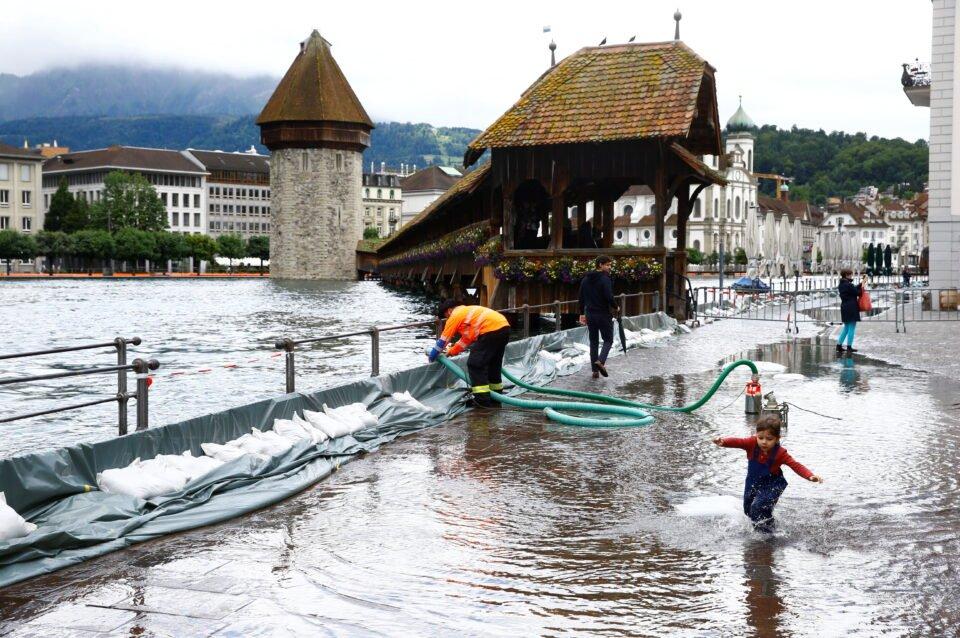 A mobile flood barrier is seen along the Reuss River in front of the Kapellbruecke bridge in Luzern, Switzerland July 15, 2021. REUTERS/Arnd Wiegmann