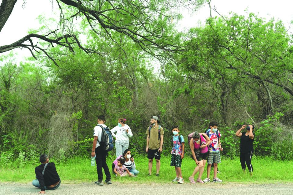 file photo: asylum seeking migrants cross the rio grande river in del rio, tx