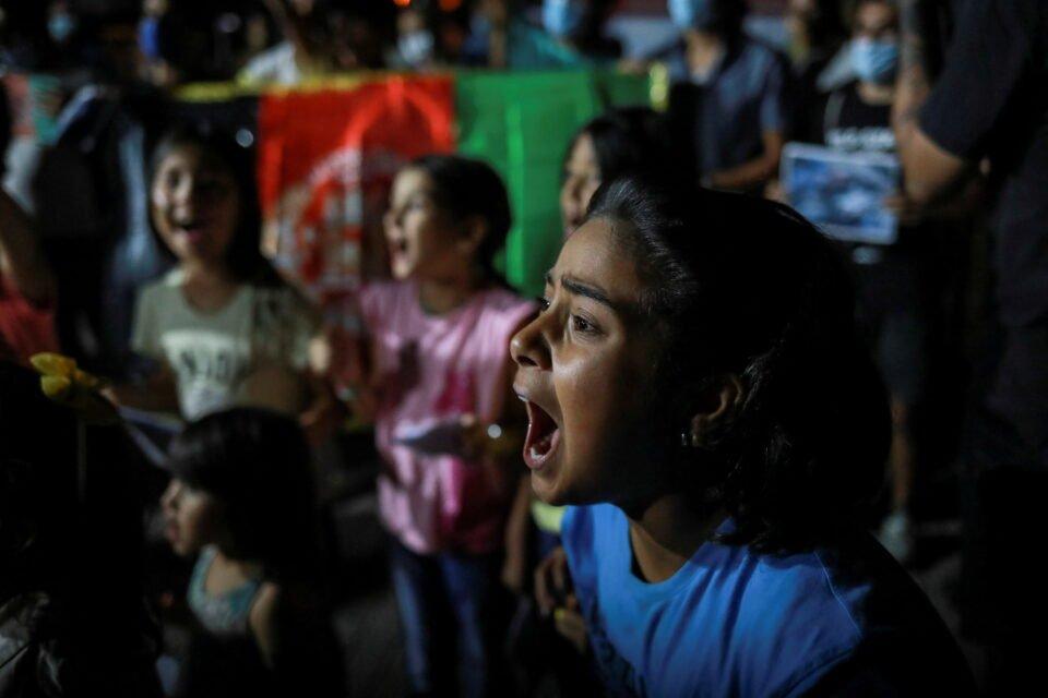 afghan migrants on lesbos island demonstrate against taliban takeover of afghanistan