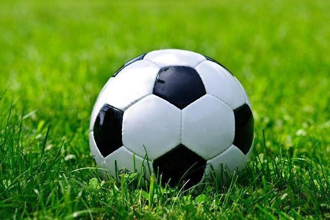 soccer ball on green grass wall mural 252de950 5e87 4f6c 8a13 7955594cf464 740x