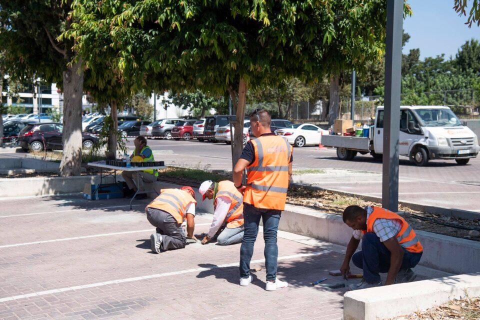 feature paul installing the smart parking equipment